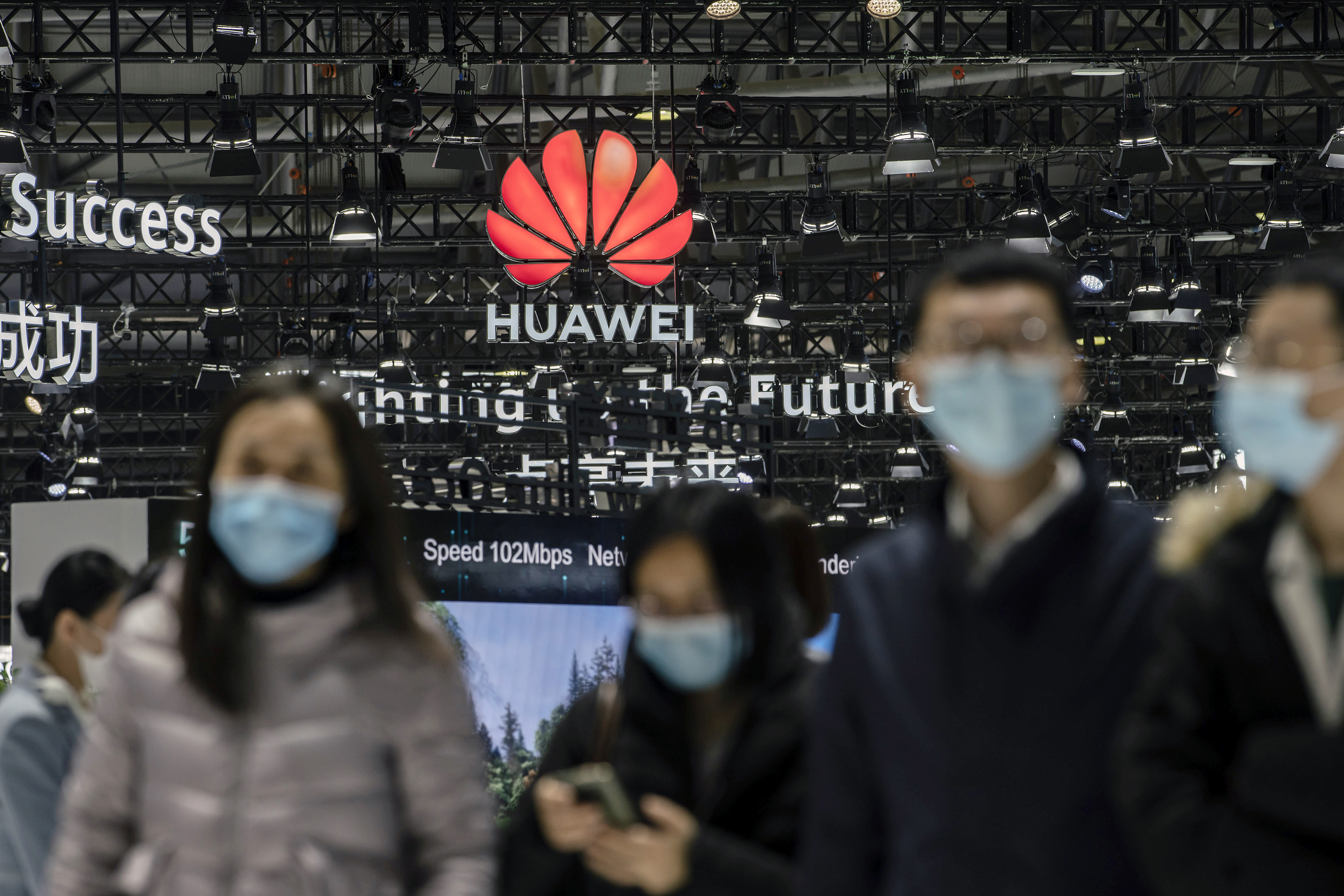 Attendees walk past the Huawei logo at the MWC Shanghai exhibition in Shanghai on Feb. 23. Photo: VCG