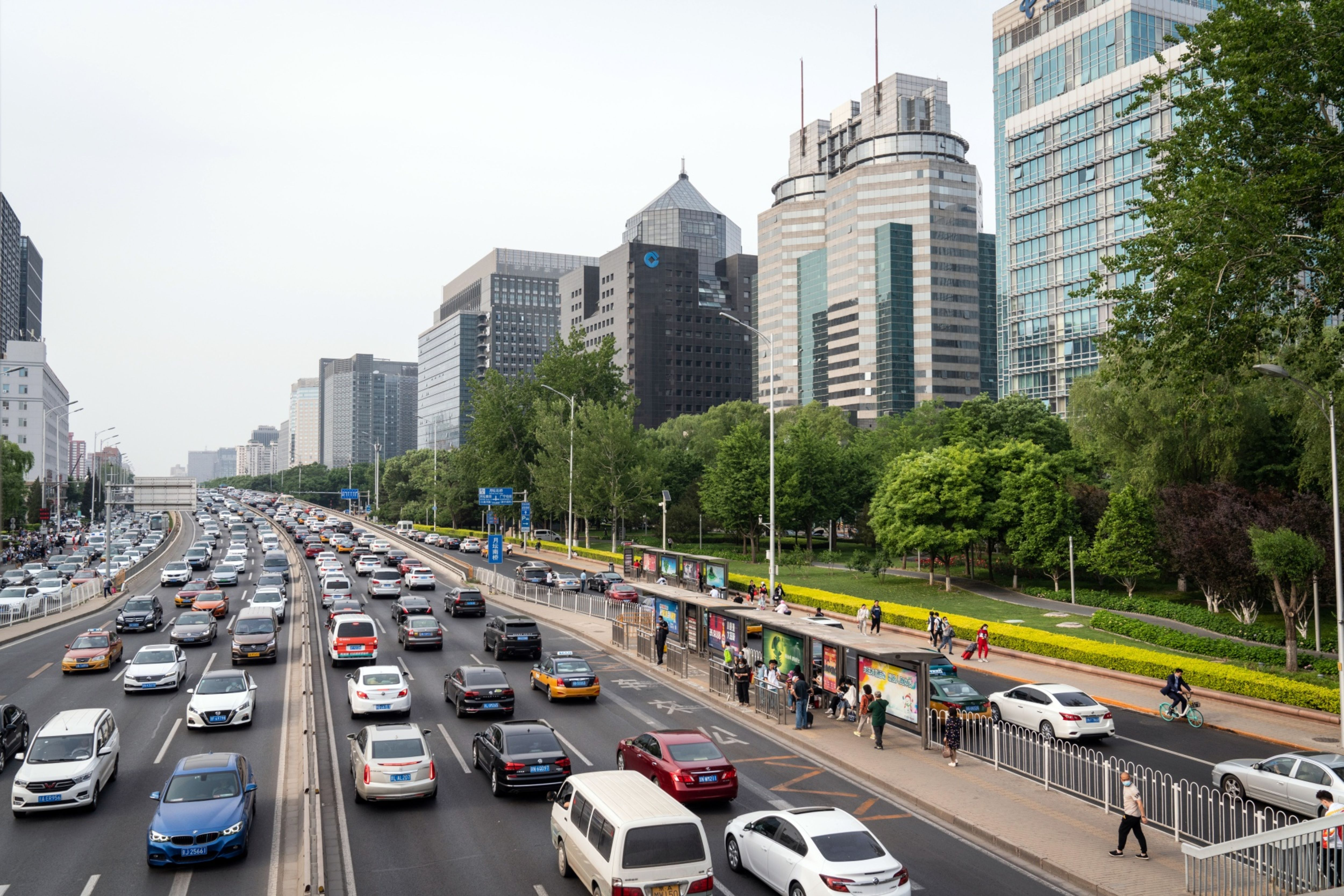 Vehicles travel along a road past buildings near Financial Street in Beijing on May 19. Photo: Bloomberg