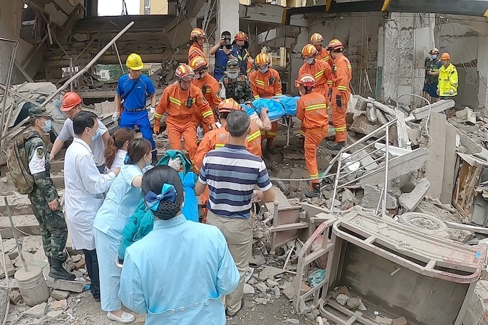 Thousands of rescuers, including firefighters and medical workers, are working at the site of a massive gas pipe explosion at the Yanhu community market of Shiyan, Central China's Hubei province