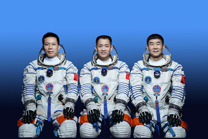 From left Tang Hongbo, Nie Haisheng and Liu Boming. Photo: Xinhua