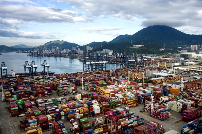 pictureShipping containers sit stacked next to gantry cranes at the Yantian International Container Terminals in Shenzhen on Sept. 6, 2019. Photo: Bloomberg