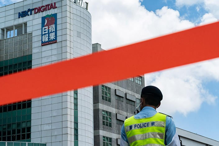 nullPolice tape surrounds the headquarters of the Apple Daily newspaper and its publisher Next Digital Ltd. on June 17 in Hong Kong. Photo: VCG