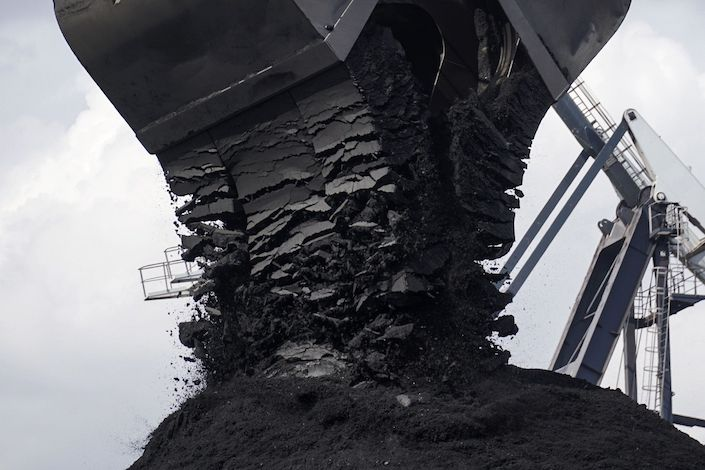 A crane unloads the first shipment of anthracite coal from U.S. supplier XCoal Energy & Resources LLC