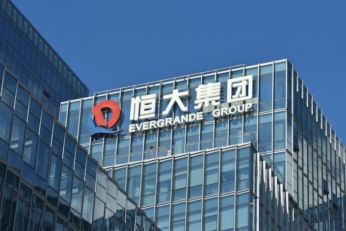 Evergrande said Wednesday that it reduced its net debt-to-equity ratio to less than 100%, meeting one of the three targets.