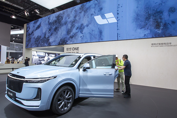 An electric car is on display at an industry event in Shanghai in April 2019. Photo: VCG