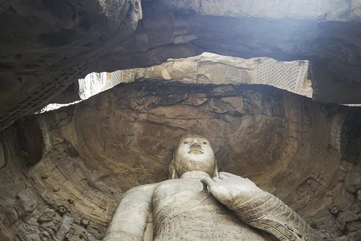 The Yungang Grottoes statue of Buddha in Datong, North China's Shanxi province. Photo: Li Xin/Caixin