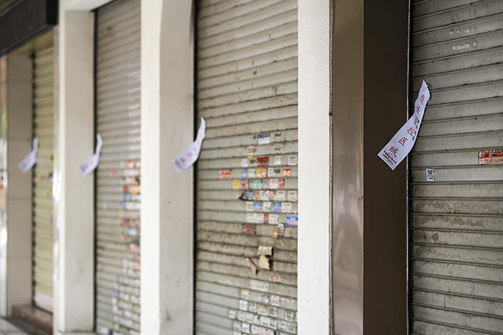 Storefronts have been shuttered on a street in Ruili, Southwest China's Yunnan province. Photo: VCG