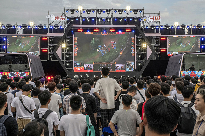 Spectators watch a broadcast of the League of Legends video game on screens during the Douyu Festival 2019 in Wuhan on June 15, 2019. Photo: Bloomberg