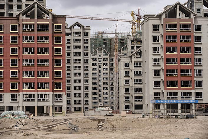 Residential buildings under construction in the new city area of Yumen, Northwest China's Gansu province on March 31, 2021. Photo: Bloomberg
