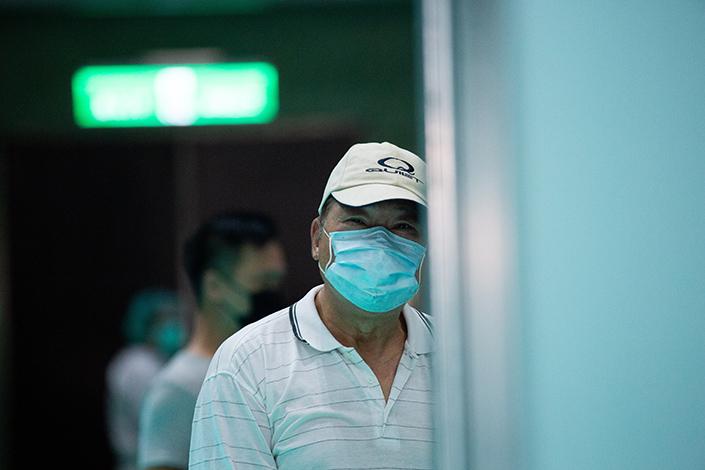 A man waits to recieve a Covid-19 vaccine in Taipei, Taiwan, on July 5. Photo: VCG