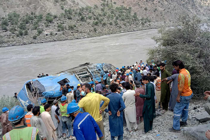 An explosion killed nine Chinese and three Pakistanis on a bus in Pakistan. China and Pakistan differed sharply over what happened.