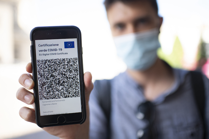 A man shows an EU digital Covid certificate on a smartphone June 20 in Turin, Italy.