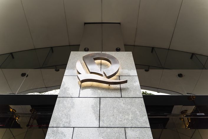 The China Evergrande Group logo is displayed in front of the China Evergrande Centre in Hong Kong