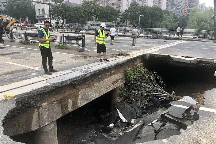 A collapsed pavement in Zhengzhou on Thursday. Photo: VCG.