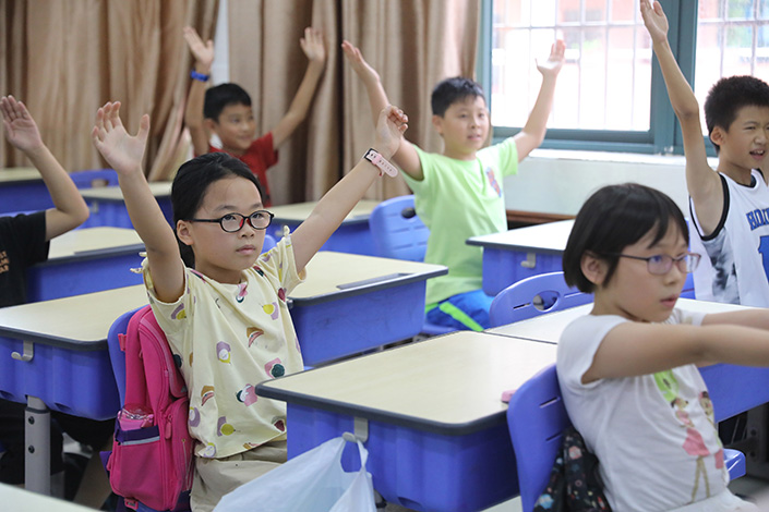 Students attend a summer tutoring class in Zhuhai, South China's Guangdong province, on July.19. Photo: VCG