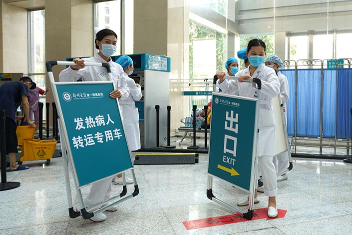 The staff of the First Affiliated Hospital of Zhengzhou University prepare for the hospital's reopening in Zhengzhou, Central China's Henan province, on Sunday. Photo: VCG.