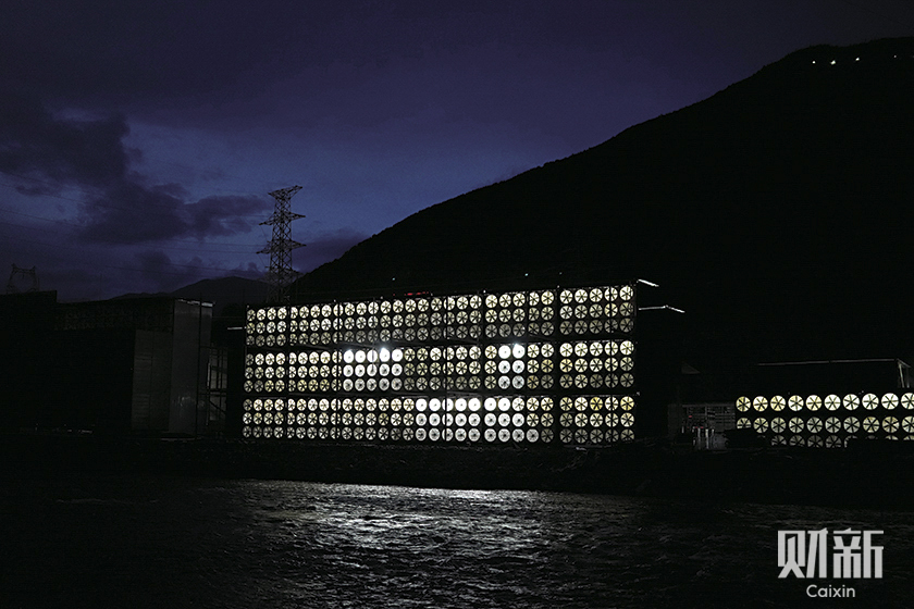 A mining center at the Ngawa Tibetan and Qiang autonomous prefecture burns the midnight oil as it takes advantage of the region's abundant hydropower during the rainy season. Photo: Ding Gang/Caixin