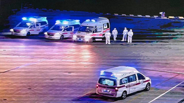Ambulances arrive at a Zhoushan dock and wait to transfer crew members to the designated medical institution for treatment on Thusday. Photo: Xinhua