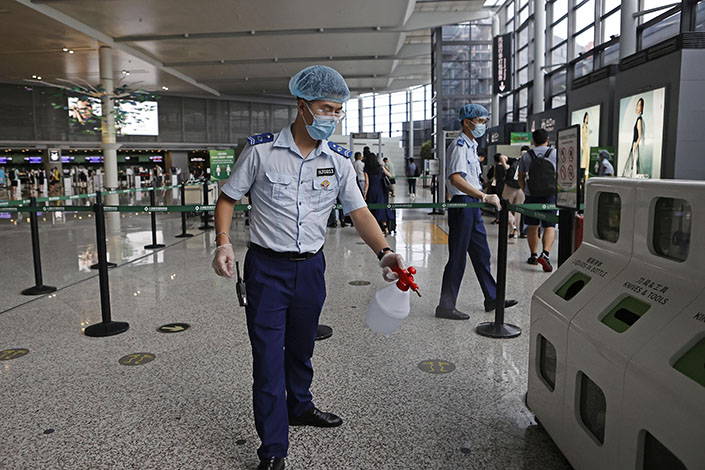A worker at Shanghai Hongqiao International Airport disinfects the ground on Aug. 1. Photo: Yin Liqin/China News Service/VCG