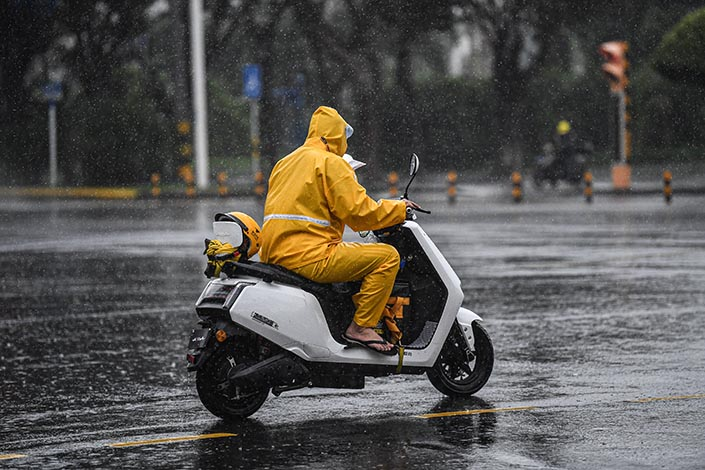 A Meituan takeout worker rides in the heavy rain in Haikou, South China's Hainan province,  in October 2020. Photo: VCG