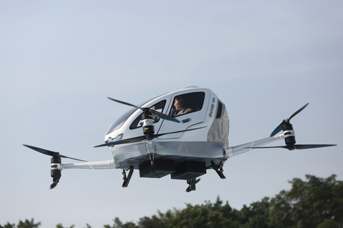 People take a ride in an EHang aircraft in Guangzhou, Guangdong province, in February 2018. Photo: VCG