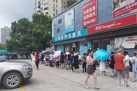 Parents outside a Greenlight Kids Education campus in Shanghai. Photo by Ren Huilan/Caixin