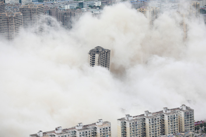 Buildings get demolished in Kunming, Southeast China's Yunnan province, on Aug. 27. Photo: VCG