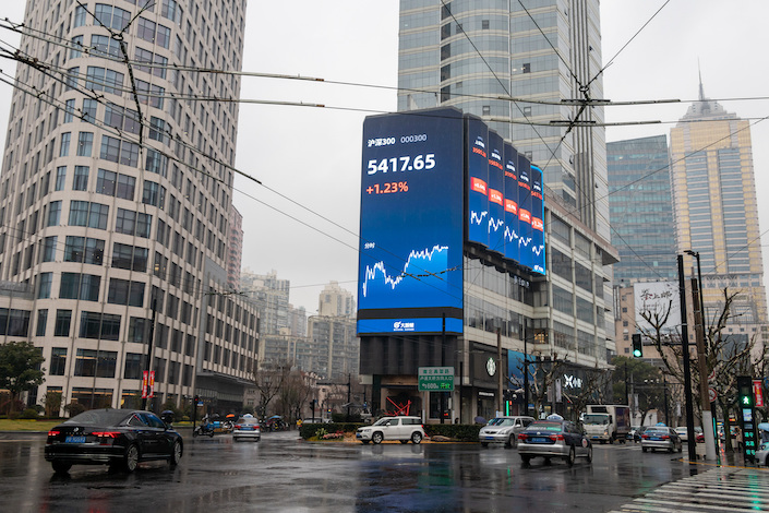 Shanghai and Shenzhen stock data on a screen outside a Shanghai building Feb. 1, 2021.