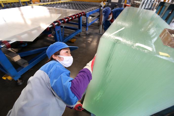 A solar panel glass production line at Henan Ancai Hi-Tech Co. Ltd.
