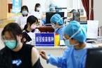 中国超10亿人已接种疫苗 77.6%覆盖率是如何达成的|数说