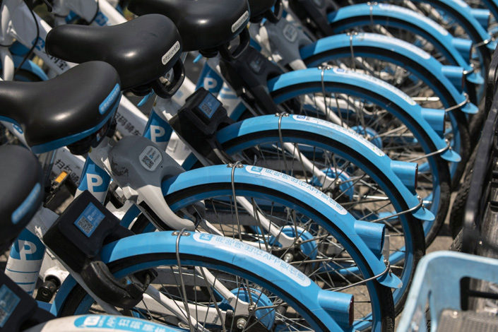 Hello Inc. bicycles sit in a row in Shanghai on April 26. Photo: Bloomberg