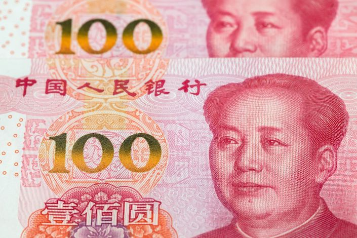 Chinese one-hundred yuan banknotes are arranged for a photograph in Hong Kong