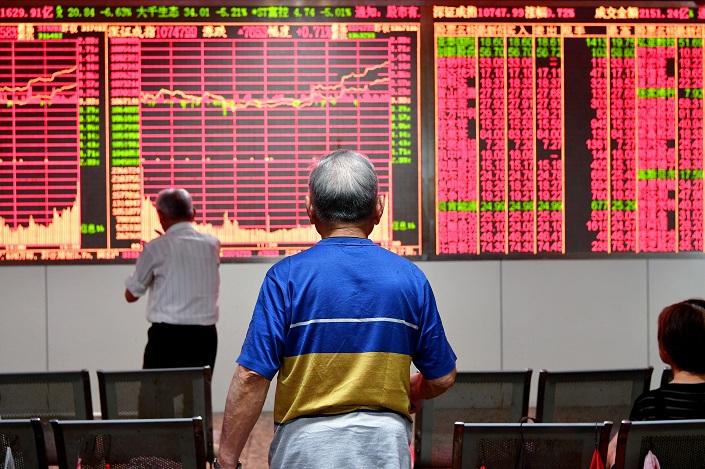 Traders monitor stocks at a trading hall in Jinhua, Zhejiang province, on May 15, 2018. Photo: VCG