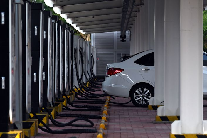 Electric cars at a charging station in Tianjin