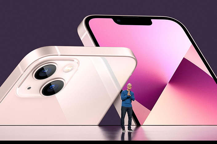 Apple CEO Tim Cook unveils the new iPhone 13 lineup during the annual iPhone event at Apple Park in California on Tuesday. Photo: VCG
