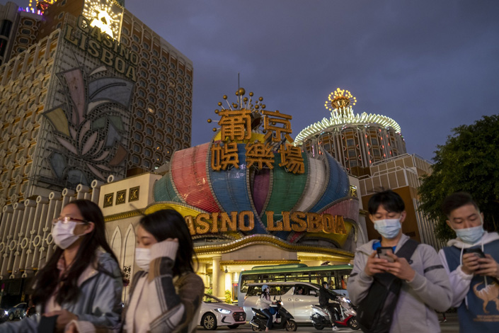 Pedestrians in face masks pass Casino Lisboa in Macao in February 2020. Photo: Bloomberg