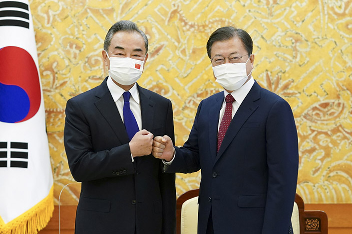 Korean President Moon Jae-in meets with visiting Chinese Foreign Minister Wang Yi in Seoul, South Korea. Photo: Xinhua