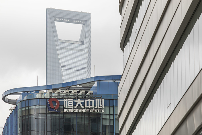 The China Evergrande Group sign atop the Evergrande Center in Shanghai on Sept. 15.  Photo: Bloomberg