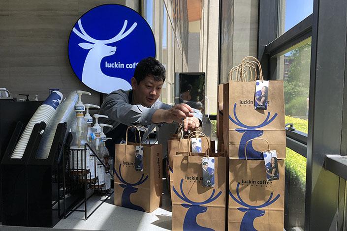 A Luckin Coffee employee prepares orders in Beijing. Photo: VCG