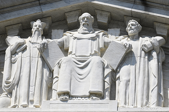 A carving of Confucius (left) can be seen under the eastern eaves of the U.S. Supreme Court in Washington.