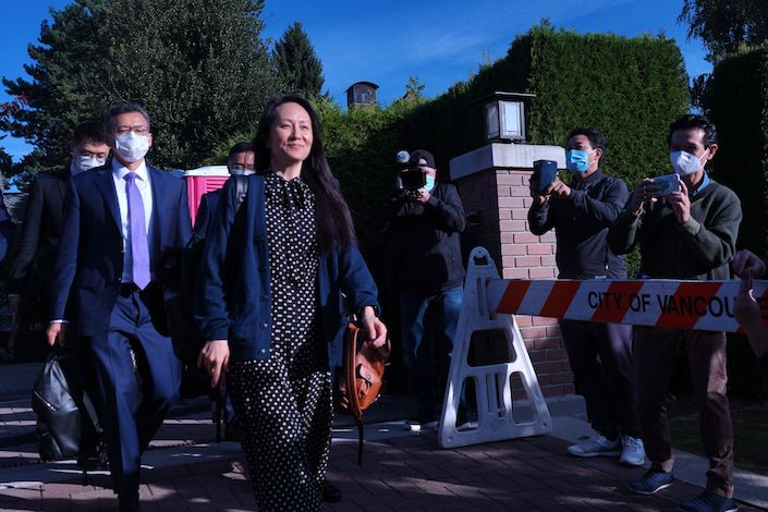 Meng Wanzhou leaves her home in Vancouver on Sept. 24.