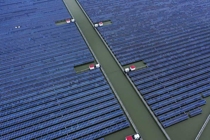 Photovoltaic panels stand in a floating solar farm in this aerial photograph taken on the outskirts of Ningbo