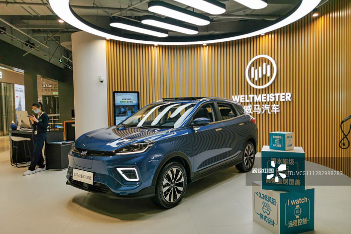 A WM EX5-Z series electric vehicle sits on display at a shopping mall in Shanghai in May 2020. Photo: VCG