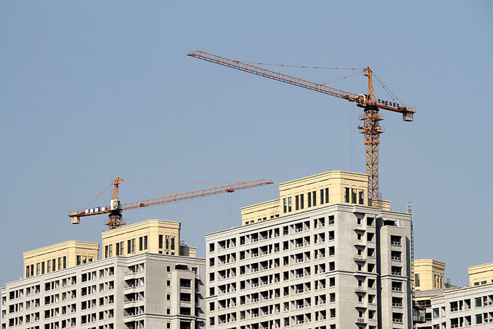 Construction cranes perch atop buildings under construction in October 2020 in Changzhou, East China's Jiangsu province. Photo: VCG