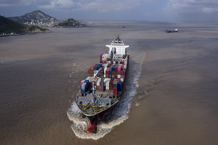 The container ship NYK Daniella sails out of the Yangshan Deepwater Port in Shanghai on Saturday. Photo: Bloomberg